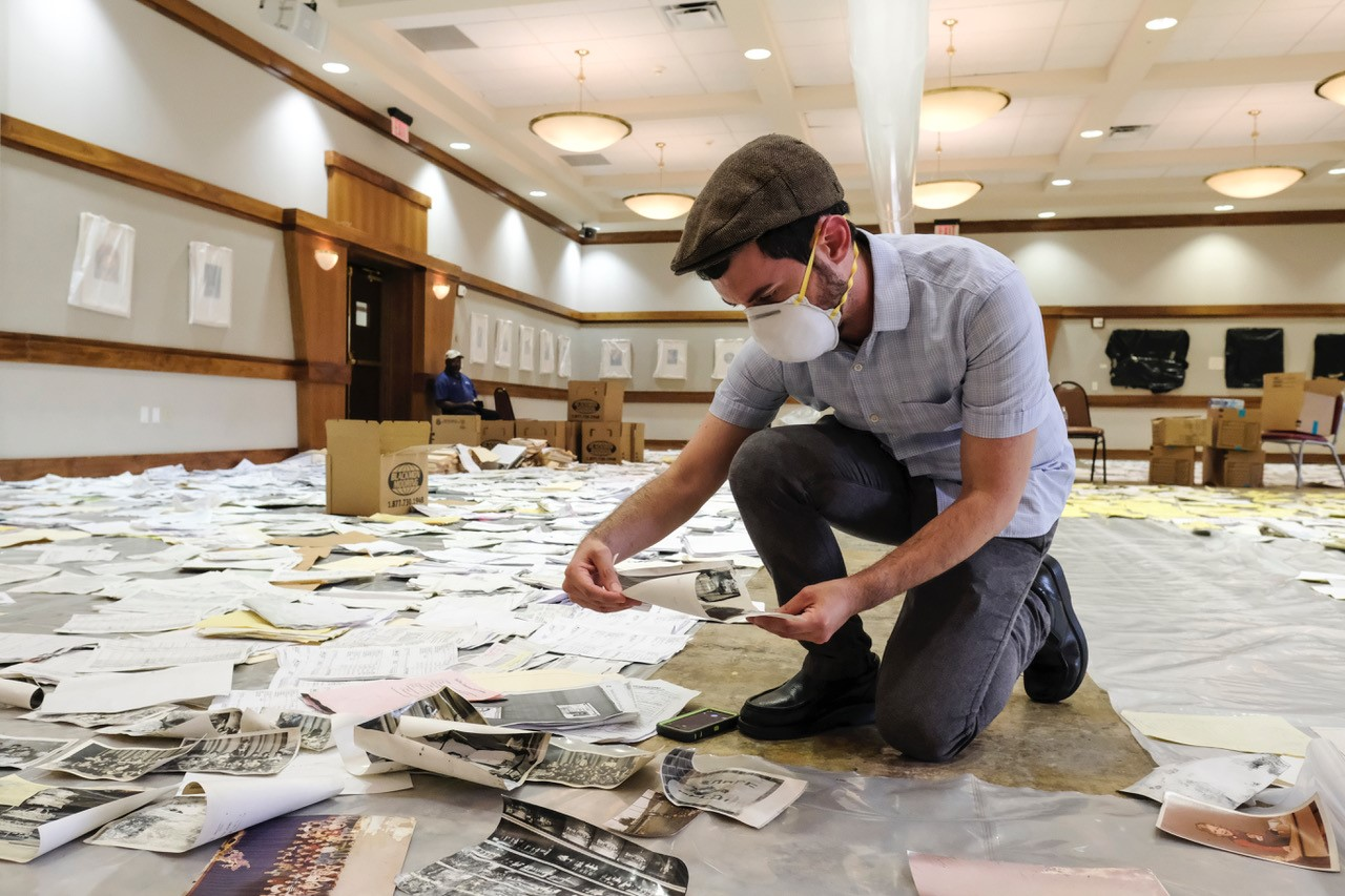 Dr. Joshua Furman assisting in recovery effort of photographs and documents at Congregation Beth Yeshurun in Houston, a week after Hurricane Harvey, September 2017. Photo credit: Michael Duke