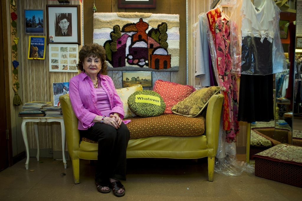 Sonia with her iconic Whatever pillow and couch, in John's Tailoring at Metcalf South Mall. (Overland Park, Kansas City.)